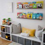 Floating Brown Wooden Shelves, White Wall, Wooden Floor, White Boxes Shelves, Bench, Pillows, Rug,