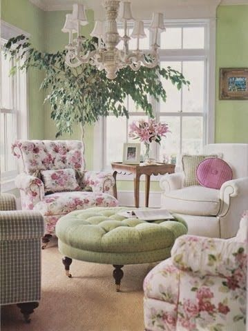 flower chair with tufted back, green round tufted ottoman, white chair, brown rug