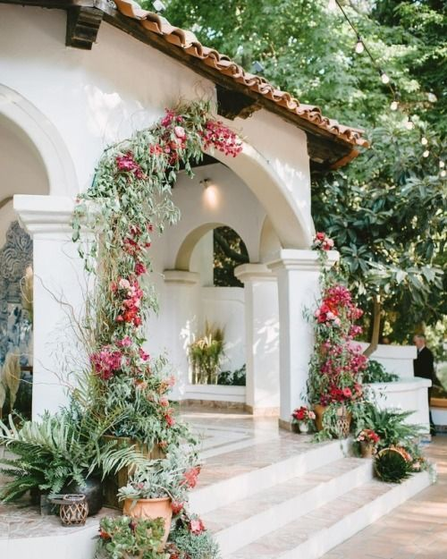 flower vine on the arch, plants on pot on the entrance, white arch, white marble floor