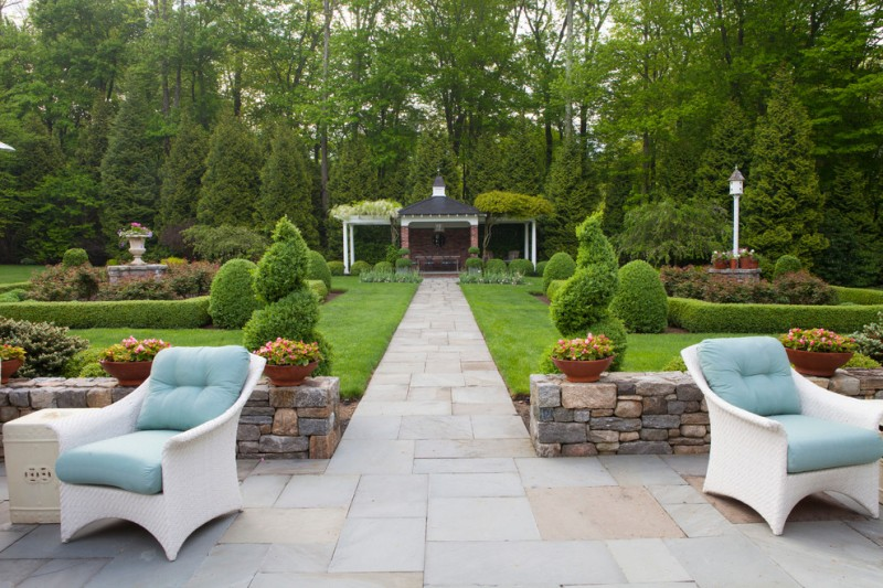 garden arbor ideas pavers whiite outdoor rattan chairs blue cushions side table grass yard trees flower fountain outdoor lamp gazebo