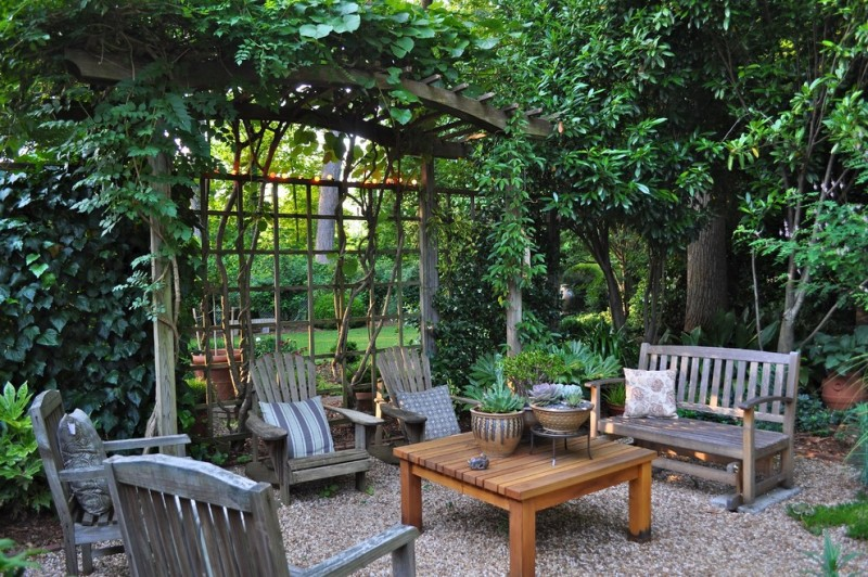 garden arbor ideas pine arbor rock space wooden coffee table plants pots rustic wooden chairs wooden bench pillows