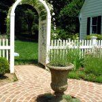 Garden Arbor Ideas Rustic Fountain Brick Pathway White Wooden Arbor White Wooden Traditional Fence White House Grass White Rose Black Glass Windows