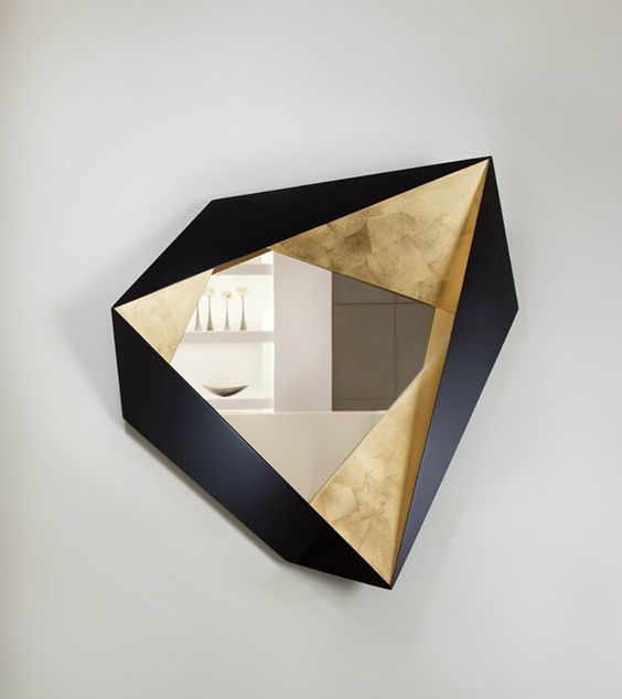 geometric mirror with black triangle, golden accent on the frame