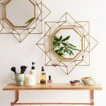 Geometric Mirror With Geometric Metal Wire Above Floating Wooden Shelves