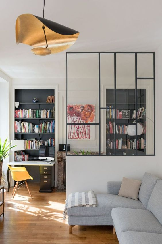 glass partition for living room, wooden floor, grey sofa, study table, shelves, artistic pendant