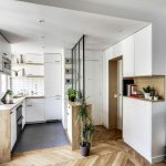 Glass Partition On Cabinet In The Kitchen, White Cabinet, Wooden Top, Wooden Chevron Floor, White Cabinet With Middle Shelves