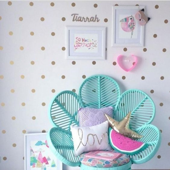 green rattan shaped like shell, golden polka dots on white wall, pillows