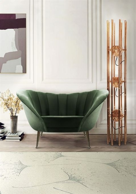 green shell long chair with metal legs, wooden floor, rug, white wall, unique shelves floor lamp