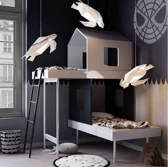 kids bedroom, grey wooden floor, grey wall, wooden bed platform shape like house, white paper pendants, laundry basket