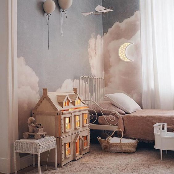 kids bedroom, pink rug, pink bedding, white metal bed platform, mini house, white rattan, cloud pattern wall, white curtain