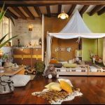 Kids Bedroom With Wooden Floor, Animal Skin Printed Rug, Wooden Low Bed With White Triangle Canopy, Wooden Beams, Beige Wall, Brown Cabinet, Wooden Low Table