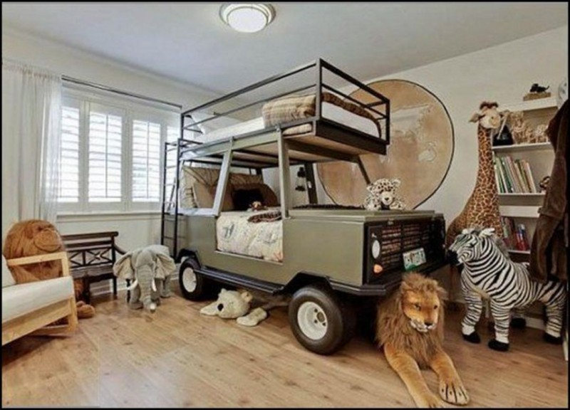 kids bedroom with wooden floor, jeep bed inside and on the roof, wooden bench with white cushion, stuffed animales, white wall, white curtain, ceiling lamp