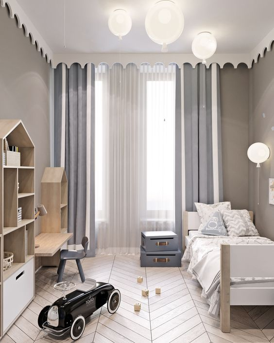 kids bedroom, wooden chevron floor, low wooden table and chair, wooden small shelves, wooden bed platform, grey wall, balloon shaped lamp on the ceiling and wall
