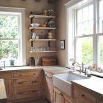 Kitchen, Brown Floor Tiles, Brown Wooden Cabinet With Black Metal Handle, Beige Wall, Floating Shelves, White Framed Window, White Sink