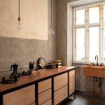 Kitchen, Copper Like Floor, Grey Beige Wall, Glass Bulbs Pendant, Wooden Cabine With Black Frame, Brown Marble Top, Sink In Different Area