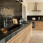 Kitchen, Open Brick Floor Tiles, Wooden Cabinet, Blak Tiles Kitchen Top, Black Backsplash Tiles, Black Sconces, Beige Wall, Hood