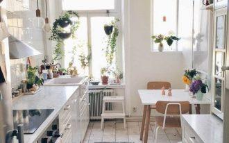 kitchen, white floor tiles, white wall, white cabinet, colorful rug, white wooden modern dining set, white tiles backsplash, bulbs pendants