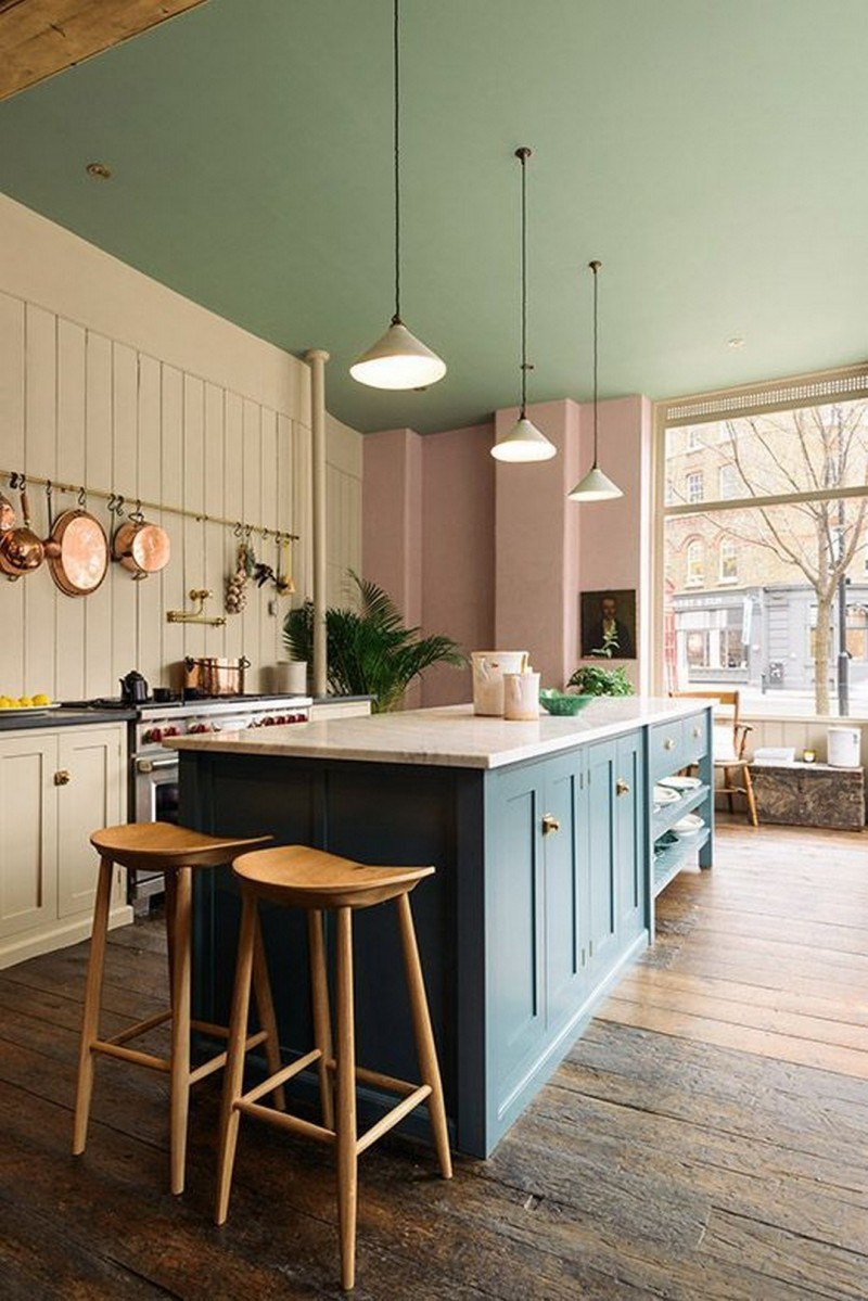 kitchen, wooden floor, soft blue wooden island, soft beige wooden wall on the cooking area, soft pink wall, soft green ceiling, pendants