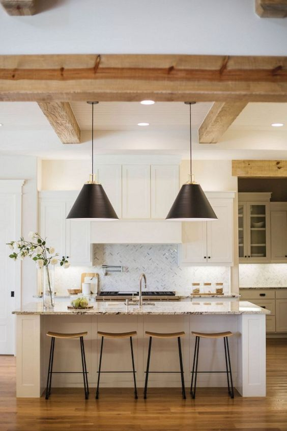kitchen, wooden floor, white marble island, white cabinet, black pendants, wooden beams, marble backsplash, sink