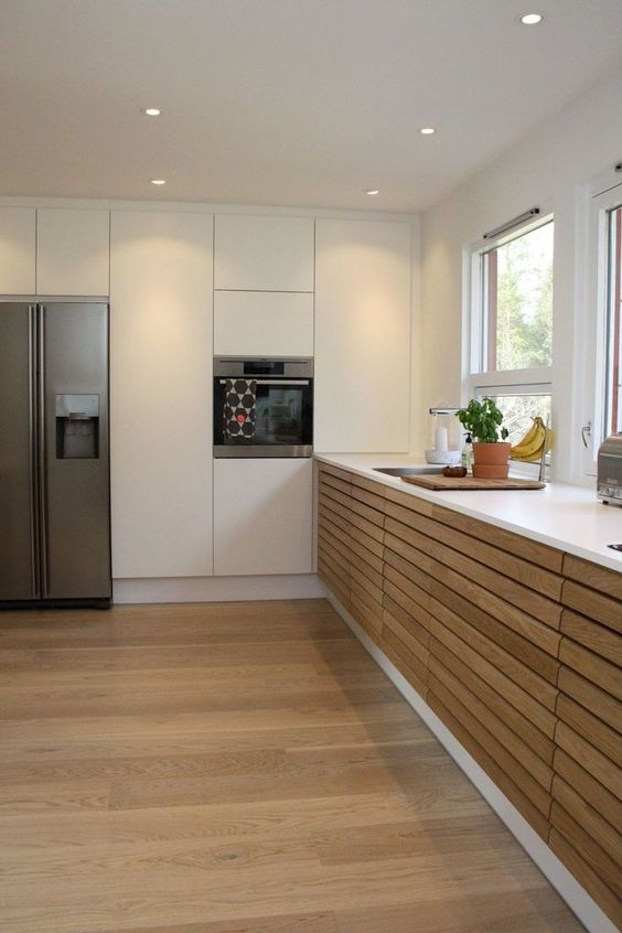 kitchen, wooden floor, wooden slabs cabinet, white top, white pantries, white wall, ceiling lamp