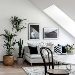 Living Room Under Sloping Ceiling, Wooden Floor, White Rug, White Modern Sofa, Rattan Pot, White Round Table, Rattan Wooden Chairs
