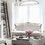 Living Room, Wooden Floor, White Studded Vintage Sofa, White Chair, White Wall, Molded Ceiling, Crystal Chandelier, Built In Shelves, Wooden Coffee Table