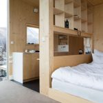 Natural Wood Look On Room Partition With Shelves, Wall, And Bed Platform