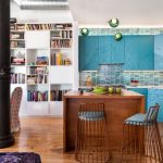Open Kitchen, Blue Textured Cabinet, Blue Tiles Backsplash, Wooden Island, Copper Stool With Blue Seating, White Book Shelves