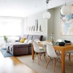Open Living Room, Grey Sofa, Wooden Floor, Grey Rugs, Wooden Table, White Modern Chairs, Gey Wall, White Pendant, White Entertainment Shelves, Floating Shelves