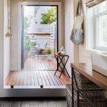 Outdoor Bathroom Ideas Wooden Flooring Glass Wall White Window Shower Head Stool Wink Rattan Basket Black Tile Gold Shower Fixtures Roman Shade