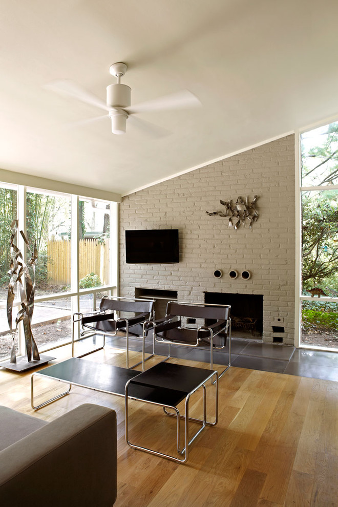 paint fireplace white ceiling fan with lamp wall decoration modern brown steel bench side table chairs chrome decor glass wall beige sofa wooden floor