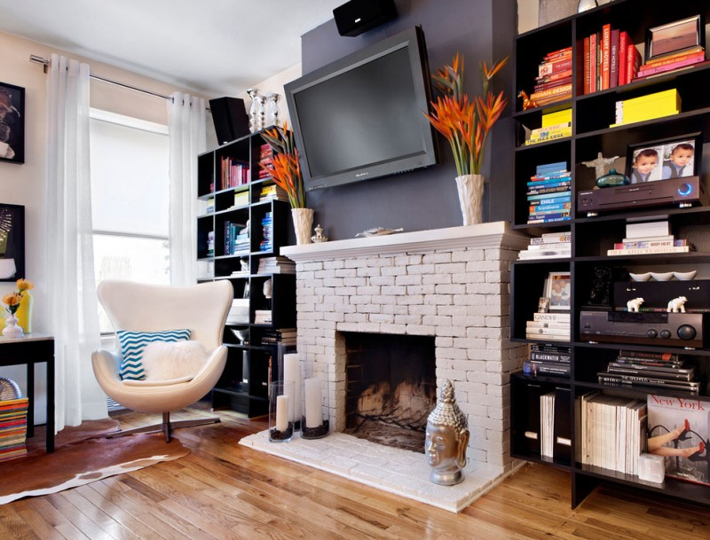 paint fireplace white fireplace brick mantel wooden floor white chair black bookshelves black wall glass window white curtains table