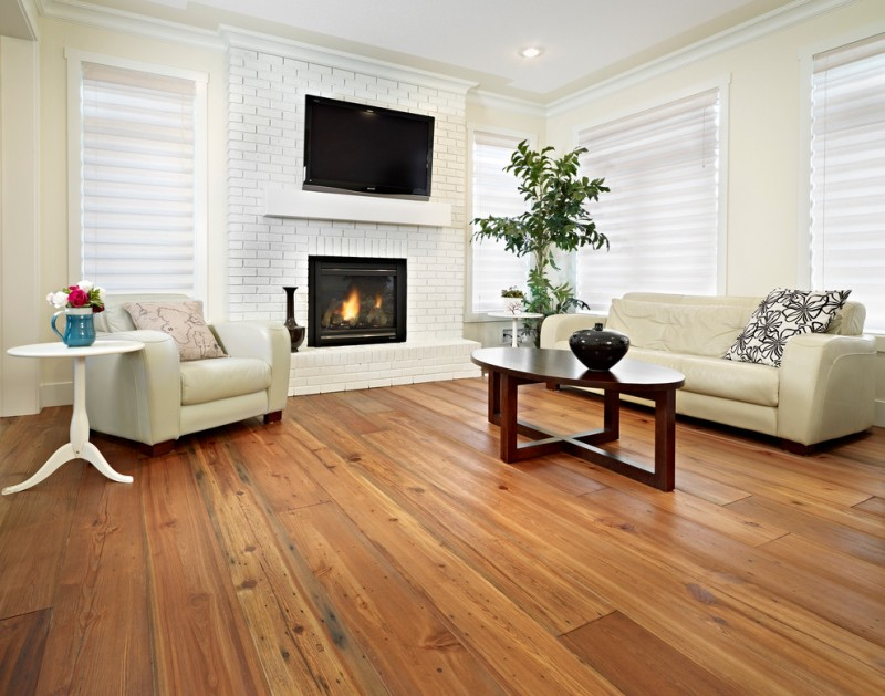 paint fireplace wooden floor wooden coffee table beige leathered soa beige armchair white side table semi gloss white brick windows white shutter pillows