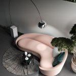 Pale Pink Curvy Sofa, Pillows, Grey Floor, Silver Floor Lamp, Plants