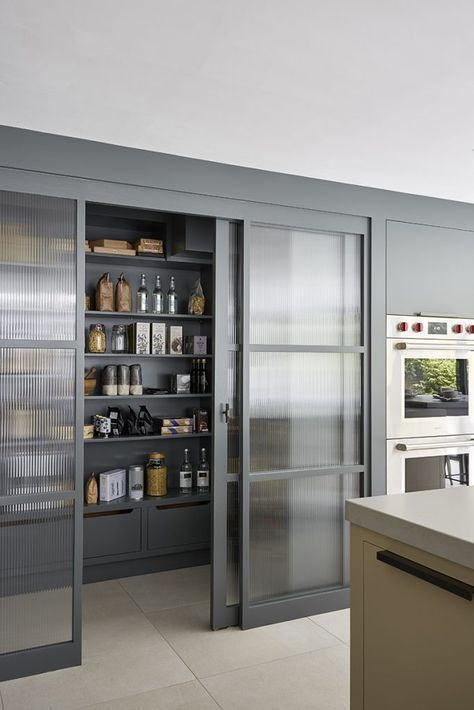 pantry room with sliding door, tall and large shelves, drawers at the bottom