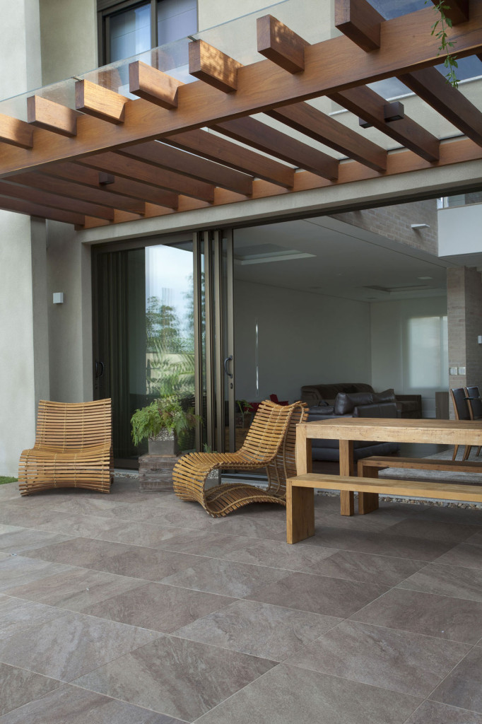 patio, grey patio floor, bamboo lounge chair, wooden table and bench, wooden pergola