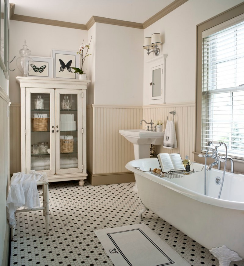 pedestal bathroom vanity beige trim white walls white cupbiard built in mirrored cabinet window freestanding tub window shutter mosaic floor stool wall sconce