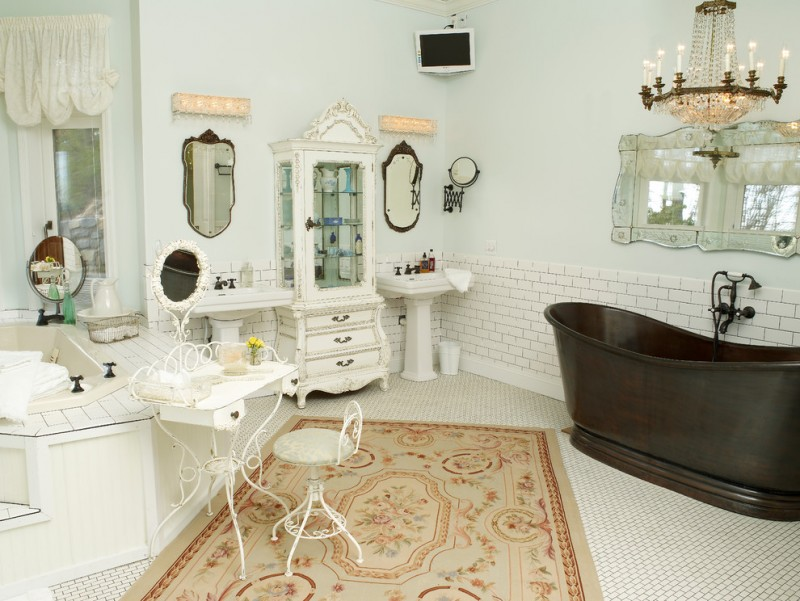 pedestal bathroom vanity vintage brown tub white mosaic tile wall mirror white cupboard crystal chandelier wall sconces white desk white stool wall sconces