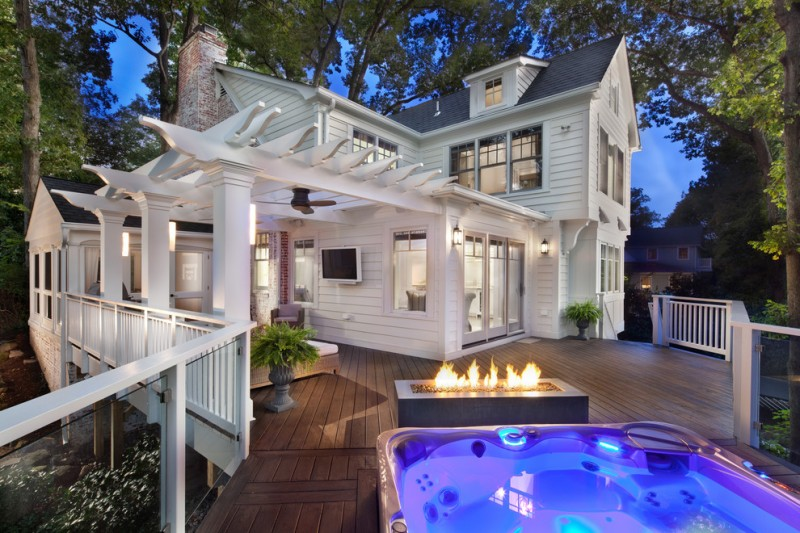 pergola on existing deck hot tub firepiy wooden floor white wooden house white wooden railing outdoor seatings glass window ceiling fan wall sconces glass railing