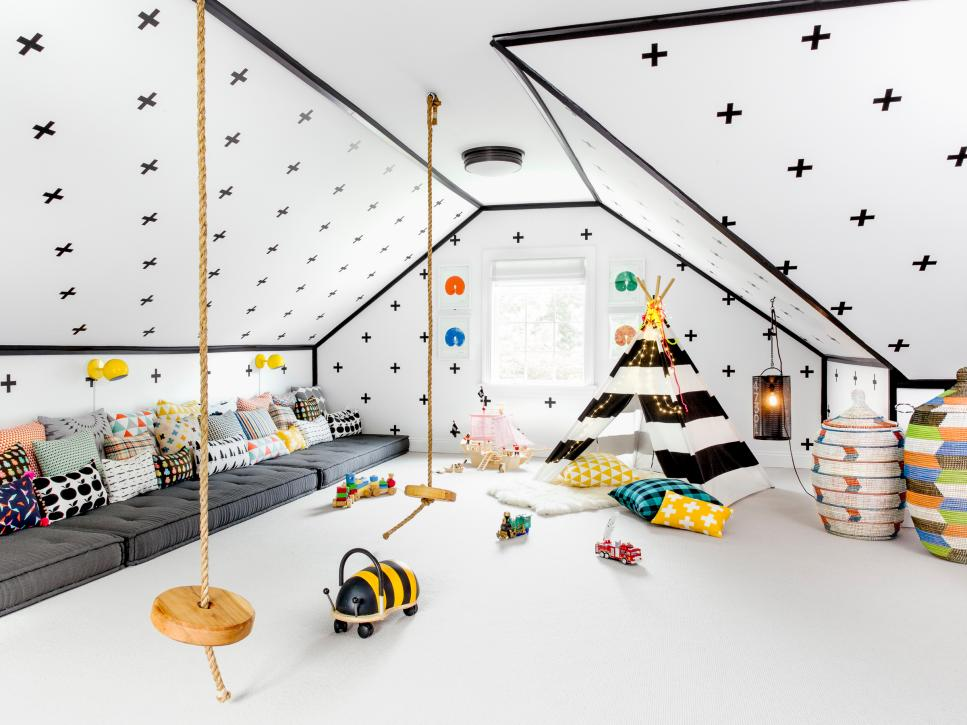 playroom, white floor, grey cushion on the floor, sloping ceiling, tent, pillows, rattan vase, toys, round swing