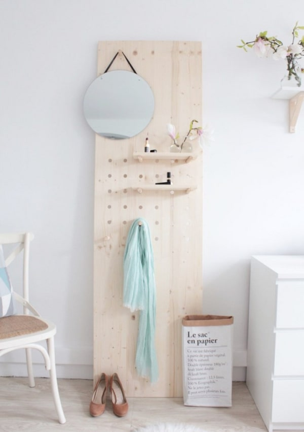 plywood, pegboard with shelves, mirror, hook