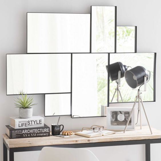rectangles mirror with different size and arrangements above wooden table