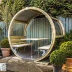 Round Glass Wheel Bench With Wooden Frame, Wooden Bench On Both Ends, White Table In The Middle