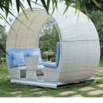 Round Rattan Pergola, Twobuilt In Benches On The End, Rattan Table In The Middle