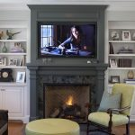 Shiplap Over Fireplace Dark Grey Fireplace Brown Sofa Colorful Pillow Yellow Ottoman Yellow Chair White Cabinets Floor Lamp Rug Shelves