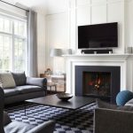Shiplap Over Fireplace White Walls Grey Rug Black Coffee Table Glass Fireplace Grey Sofas Leathered Chair Glass Table Lamp Window Grey Curtain