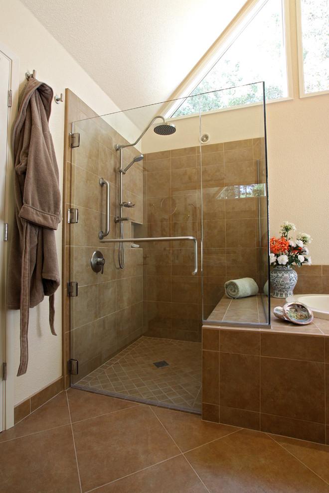 shower pan tiles brown tiles glass shower door windows shower head towel hook built in tub beige walls built in shelf bench