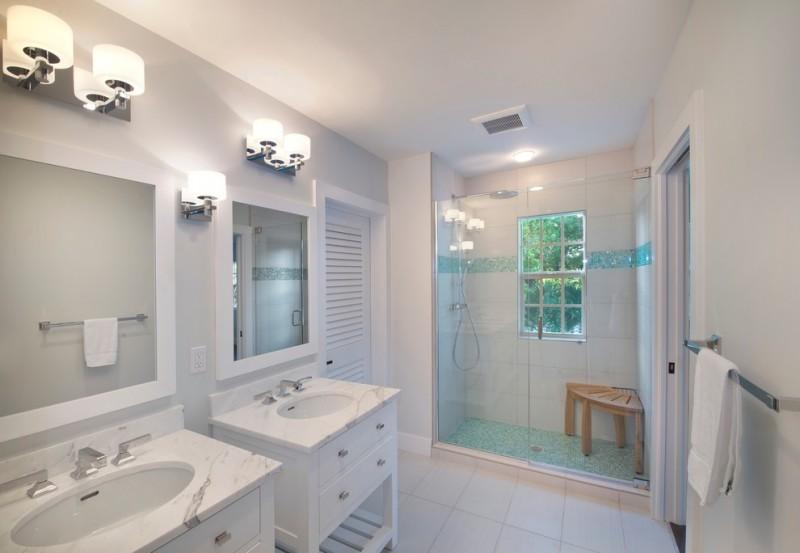 shower pan tiles mosaic tiles white wall tile window wooden corner bench wall sconces white vanities sinks wall sconces wall mirror shower fixture glass doors