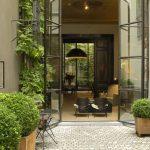 Small Garden With Grey Patio Brick Floor, Green Bush On Wooden Pots, Green Plants On The Corner