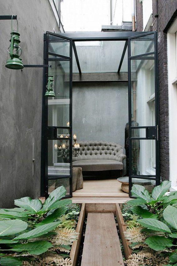 small garden, wooden pat, plants on wooden pots, glass doors, pendant